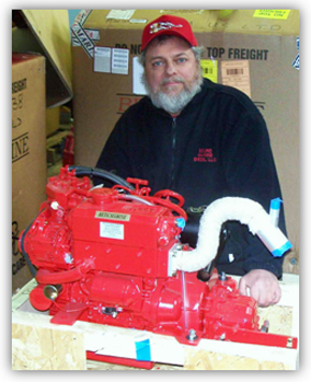Joe DeMers with engine